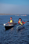 Sea kayaking couple, Port Townsend, Puget Sound, Washington State, Pacific Northwest, West Coast Sea Kayak Symposium.