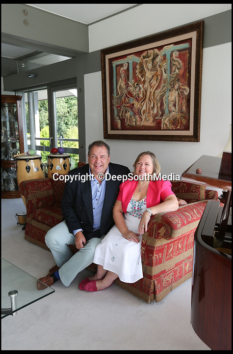 BNPS.co.uk (01202 558833)<br /> Pic: DeepSouthMedia/BNPS<br /> <br /> No Sale - Mark (61) and Sharon Beresford (57) in their stunning Huf haus.<br /> <br /> Questions have been asked after the winner of a raffle to win a luxury house was given only £110,000 out of the £750,000 raised<br /> <br /> Mark and Sharon Beresford set up the quirky competition in an attempt to sell their £3m home, Avon Place in Ringwood, Hants but sold just 30,000 tickets out of the 250,000 they needed.<br /> <br /> The raffle raised a whopping £750,000 however the winner of the failed venture recieved just £110,070 - 27 times less than the value of the property.