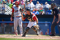 Batavia Muckdogs catcher Blake Anderson (26) checks the runner after blocking a pitch in front of Gregori Rivero (26) during a game against the Williamsport Crosscutters on July 16, 2015 at Dwyer Stadium in Batavia, New York.  Batavia defeated Williamsport 4-2.  (Mike Janes/Four Seam Images)
