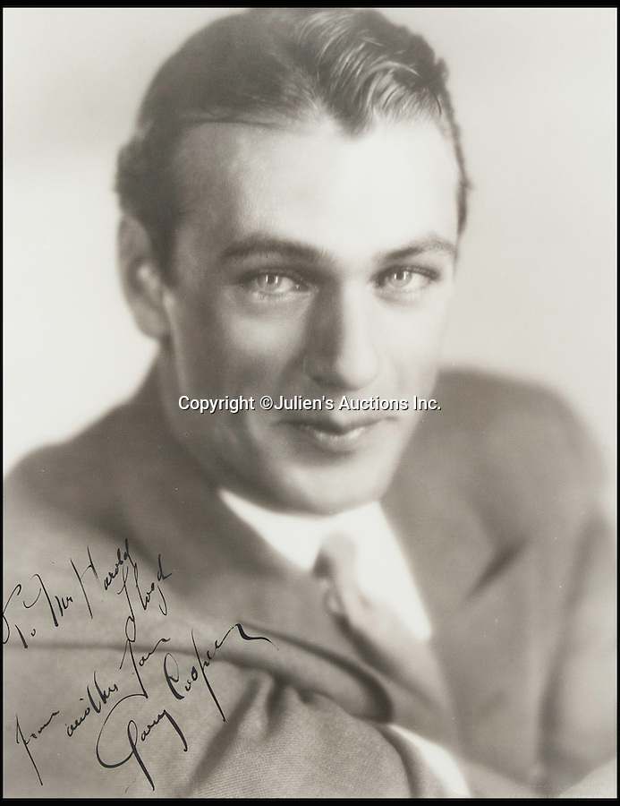 BNPS.co.uk (01202 558833)<br /> Pic: JuliensAuctions/BNPS<br /> <br /> Screen icon Gary Cooper.<br /> <br /> The Rogues Gallery - Unique Who's who from the halcyon days of Hollywood collected by one of their own, comedian Harold Lloyd.<br /> <br /> The silent movie actor asked his silver screen chums to send him their best loved publicity shots one Xmas, so he could create a 'Rogues Gallery' at his Hollywood mansion.<br /> <br /> The unique collection reveals tinsel town as it preferred to see itself in its most glamourous era between the wars.