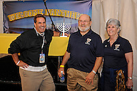 20 December 2011:  Former CNN anchor Rick Sanchez (left) and FIU NCAA Faculty Representative Dr. Stephen Fain (right) and his wife flank a menorah, which was later lit prior to the game in celebration of the Jewish holiday of Chanukah, which started tonight.  The Marshall University Thundering Herd defeated the FIU Golden Panthers, 20-10, to win the Beef 'O'Brady's St. Petersburg Bowl at Tropicana Field in St. Petersburg, Florida.
