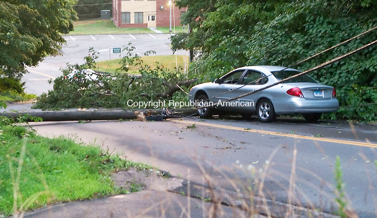 WATERBURY, CT- 03 AUGUST 06- 080306JT04-<br /> A driver drove into a fallen utility pole on Country Club Road, in an area where a large tree also fell, as a strong thunderstorm passed through the area on Thursday evening. <br /> Josalee Thrift Republican-American