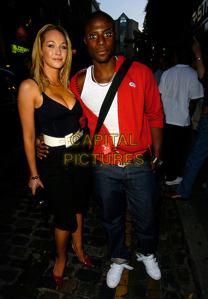 LEO IHENACHO & GUEST.G-Star Raw - London shop launch, G Star Raw, London, UK..August 9th, 2006.Ref: CAN.full length jeans denim red black dress.www.capitalpictures.com.sales@capitalpictures.com.©Can Nguyen/Capital Pictures