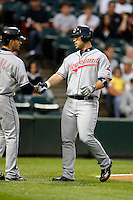 August 7, 2009:  Catcher Kelly Shoppach (10) of the Cleveland Indians is greeted by Jamey Carroll after hitting a home run during a game vs. the Chicago White Sox at U.S. Cellular Field in Chicago, IL.  The Indians defeated the White Sox 6-2.  Photo By Mike Janes/Four Seam Images