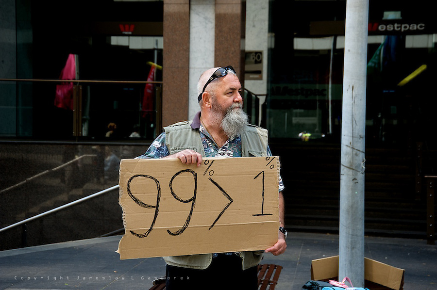 "More than 1000 people demonstrate in Sydney at Martin Place on Saturday of October 15 calling for an end to ""greed"" and to reject the policies that have ""enriched 1 per cent of the world's population at the expense of the other 99"". Similar protests take place in almost 1000 cities all over the World."