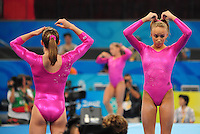 Aug. 7, 2008; Beijing, CHINA; Nastia Liukin (right) adjusts her hair during womens gymnastics training prior to the Olympics at the National Indoor Stadium. Mandatory Credit: Mark J. Rebilas-