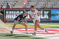 College Park, MD - April 27, 2019: Maryland Terrapins attack Brindi Griffin (1) is being defended by John Hopkins Bluejays Jeanne Kachris (21) during the game between John Hopkins and Maryland at  Capital One Field at Maryland Stadium in College Park, MD.  (Photo by Elliott Brown/Media Images International)