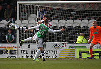Jeroen Tesselaar gets to the ball before Leigh Griffiths in the St Mirren v Hibernian Clydesdale Bank Scottish Premier League match played at St Mirren Park, Paisley on 29.4.12.
