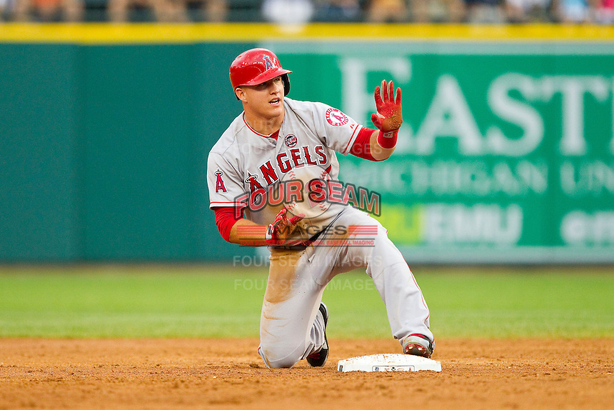 Mike Trout (27) of the Los Angeles Angels asks the umpire for time after stealing second base against the Detroit Tigers at Comerica Park on June 25, 2013 in Detroit, Michigan.  The Angels defeated the Tigers 14-8.  (Brian Westerholt/Four Seam Images)