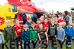 John Kearney, chairperson of the Irish Community Tapid Response Unit pictured with listowel children when the Rapid Response helicopter landed in Listowel Emmets GAA grounds on Saturday last.