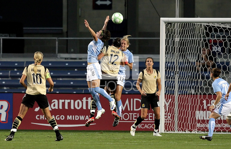 FC Gold Pride forward Christine Sinclair (12) is fouled by Chicago Red Star midfielder Megan Rapinoe (8) and defender Natalie Spilger (13), resulting in an FC Gold Pride penalty kick.   The Chicago Red Stars defeated the FC Gold Pride 3-1 at Toyota Park in Bridgeview, IL on July 12, 2009.