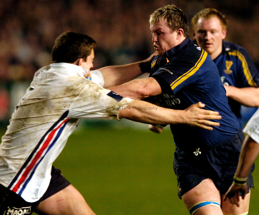 Photo: Richard Lane..Leinster Lions v Sale Sharks. Heinenken Cup. 09/01/2004..Eric Miller hands off Andrew Sheridan.