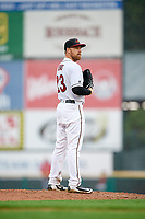Rochester Red Wings starting pitcher Dietrich Enns (23) looks in for the sign during a game against the Scranton/Wilkes-Barre RailRiders on June 24, 2018 at Frontier Field in Rochester, New York.  The game was suspended in the fourth inning due to inclement weather.  (Mike Janes/Four Seam Images)