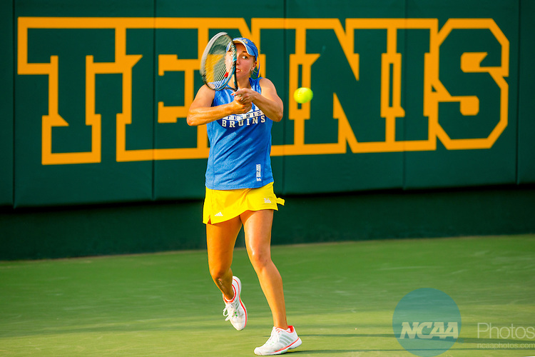 19 MAY 2015:  Catherine Harris of UCLA returns a serve during The Division I Women's Tennis Championship held at the Hurd Tennis Center on the Baylor University campus in Waco, TX.  Vanderbilt defeated UCLA 4-2 to win the team national title.  Darren Carroll/NCAA Photos