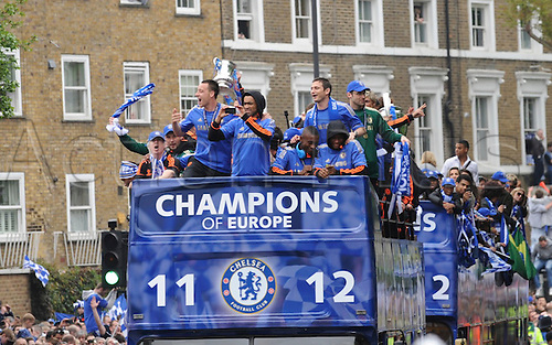 20.05.2012 Chelsea London, England..Champions League Cup Winners Parade atop the traditional open-top bus to the Stamford Bridge Ground. Picture shows the team saluting the supporters