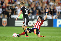 Washington, D.C.- July 20, 2014. Conor Doyle (30) of D.C. United goes against Marky Delgado.  D.C. United defeated Chivas USA 3-1 during a Major League Soccer Match for the 2014 season at RFK Stadium.
