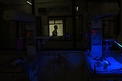 A new born baby sleeps under the phototherapy machine in the nursery of the Duncan Hospital in Raxaul, Bihar, India.