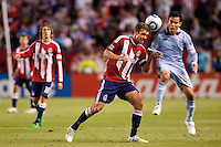 Chivas USA defender Jimmy Conrad (12) beats Sporting Kansas City DP forward Omar Bravo (99). Sporting KC defeated CD Chivas USA 3-2 at Home Depot Center stadium in Carson, California on Saturday March 19, 2011...