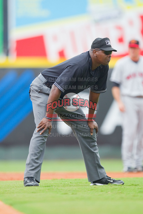 Third base umpire Art Thigpen during an International League game between the Rochester Red Wings and the Charlotte Knights at Knights Stadium August 1, 2010, in Fort Mill, South Carolina.  Photo by Brian Westerholt / Four Seam Images