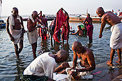 Hindu pilgrims wash their clothes and bathe on the ghats in the ancient city of Varanasi in Uttar Pradesh, India. Photograph: Sanjit Das/Panos