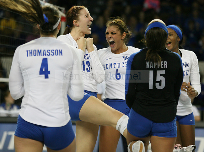 The team reacts to scoring during the UK vs. LSU women's volleyball game at Memorial Coliseum in Lexington, Ky., on Sunday, November 10, 2013. UK won the set 3-2. Photo by Tessa Lighty | Staff
