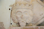 Stone carved face of King Henry II second, lived 1133-1189, St Mary parish church, Benhall, Suffolk, England, UK