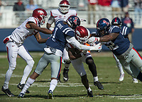 Hawgs Illustrated/BEN GOFF <br /> T.J. Hammonds, Arkansas running back, tries to split D.D. Bowie, Ole Miss cornerback, and Austrian Robinson, Ole Miss defensive tackle, on a run in the fourth quarter Saturday, Oct. 28, 2017, at Vaught-Hemingway Stadium in Oxford, Miss.