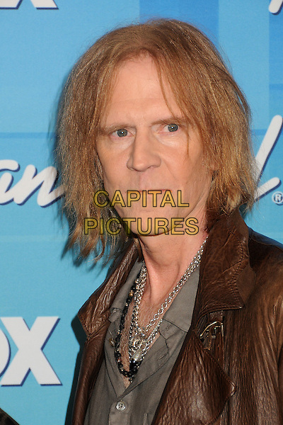 Tom Hamilton, Aerosmith.American Idol Season 11 Finale - Press Room held at Nokia Theatre LA Live, Los Angeles, California, USA..May 23rd, 2012.headshot portrait brown leather .CAP/ADM/BP.©Byron Purvis/AdMedia/Capital Pictures.