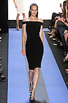 Alla walks runway in a carbon black crepe off shoulder cocktail dress with side leather panel, by Monique Lhuillier, from the Monique Lhuillier Spring 2012 collection fashion show, during Mercedes-Benz Fashion Week Spring 2012.