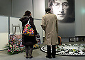 SAITAMA - DEC. 5: Fans at the memorial set up each year at the John Lennon Museum in Saitama, Tokyo, on the anniversary of the assasination of John Lennon: December 8th, 1980. (Photo by Alfie Goodrich/Nippon News)