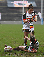 Picture by Anna Gowthorpe/SWpix.com - 15/04/2018 - Rugby League - Womens Super League - Bradford Bulls v Leeds Rhinos - Coral Windows Stadium, Bradford, England - Bradford Bulls' Stacey Greenwood is helped by a team-mate