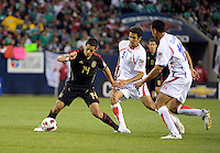 Mexico's Javier Hernandez is surrounded by Costa Rica's Celso Borges and Oscar Duarte.  Mexico defeated Costa Rica 4-1 at the 2011 CONCACAF Gold Cup at Soldier Field in Chicago, IL on June 12, 2011.