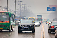 Imported Audi 4-wheel-drive vehicle in traffic on Xian main street, China