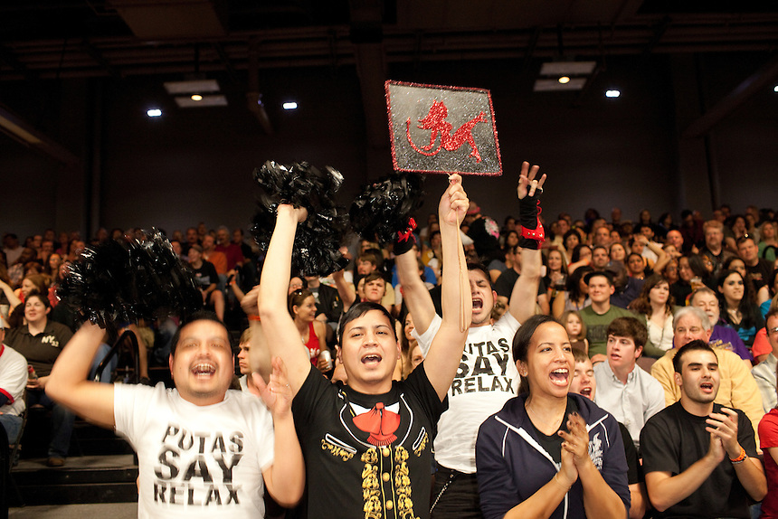 Fans of Putas del Fuego cheer their team during a bout against the Hellcats at the Palmer Events Center in Austin, Texas.