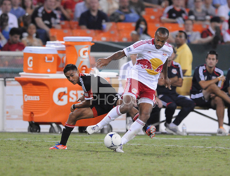 New York Red Bulls forward Thierry Henry (14) shields the ball from D.C. United defender Andy Najar (14) The New York Red Bulls tied D.C. United 2-2 at RFK Stadium, Wednesday August 29, 2012.