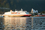 Hurtigruten ferry ship Nordlys approaching Tromso, Norway past the Arctic cathedral