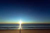 Solitary person walking on the beach at sunrise, Nauset Beach, Cape Cod, Massachusetts, USA