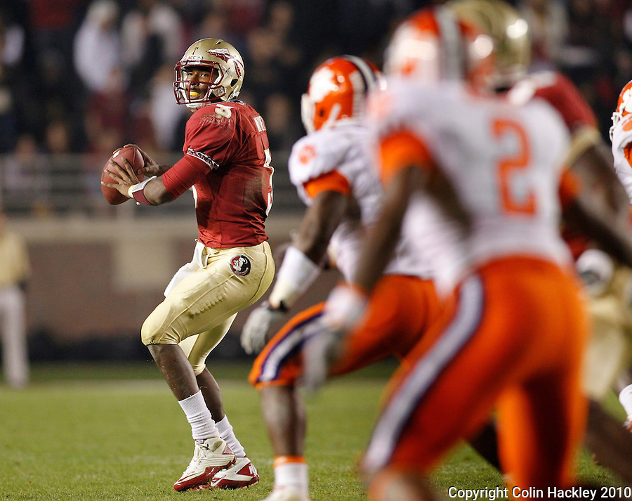 TALLAHASSEE, FL 11/13/10-FSU-CLEMSON FB10 CH-Florida State quarterback EJ Manuel looks for a receiver against Clemson during second half action Saturday at Doak Campbell Stadium in Tallahassee. The Seminoles beat the Tigers 16-13..COLIN HACKLEY PHOTO