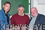 CARDS: Sean Behan (Loughill), Tom Keane (Tralee) and Jack Walsh (Fenit) marking their cards after the second race at Kingdom Greyhound Stadium, Tralee, on Saturday night..