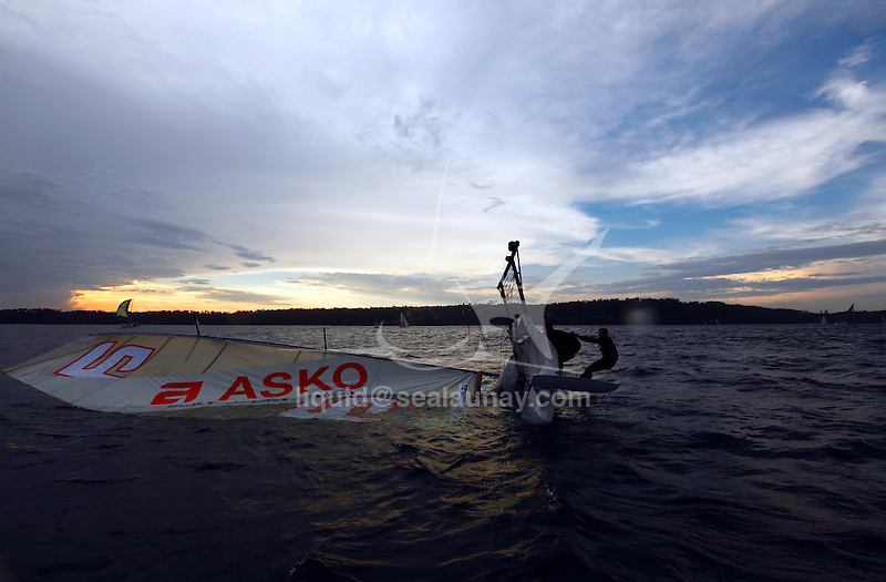 Capsize of the 18 feet Asko in Sydney Harbour..The Giltinan Championship has always been regarded as the world's championship of 18 footer racing (the one they all want to win) since the first regatta was sailed on Sydney Harbour in January 1938.