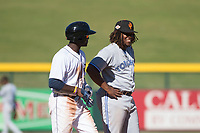 Surprise Saguaros third baseman Vladimir Guerrero Jr. (27), of the Toronto Blue Jays organization, chats with Daz Cameron (13), of the Detroit Tigers organization, during an Arizona Fall League game against the Mesa Solar Sox at Sloan Park on November 1, 2018 in Mesa, Arizona. Surprise defeated Mesa 5-4 . (Zachary Lucy/Four Seam Images)