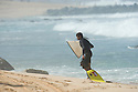 Chris Won Taloa .(HAW) after breaking his board in half in a heavy wipe out at Pipeline on the Northshore of Oahu in Hawaii.
