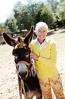 Liisa Joronen, founder of Finnish corporation SOL, poses for the photographer with a donkey at her home in the Var, France, 11 April 2012