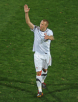 Jay DeMerit of USA waves to the fans. Ghana defeated the USA 2-1 in overtime in the 2010 FIFA World Cup at Royal Bafokeng Stadium in Rustenburg, South Africa on June 26, 2010.