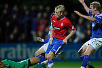 Steven Naismith taps the ball past keeper Roy Lodovic to open the scoring