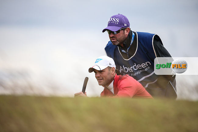 Martin Kaymer (GER) and caddie Craig Connelly during Round One of the 2016 Aberdeen Asset Management Scottish Open, played at Castle Stuart Golf Club, Inverness, Scotland. 07/07/2016. Picture: David Lloyd | Golffile.<br /> <br /> All photos usage must carry mandatory copyright credit (&copy; Golffile | David Lloyd)
