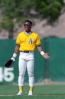 PHOENIX, AZ - Rickey Henderson of the Oakland Athletics jokes around during a spring training game against the San Francisco Giants at Phoenix Municipal Stadium in Phoenix, Arizona in 1992. Photo by Brad Mangin
