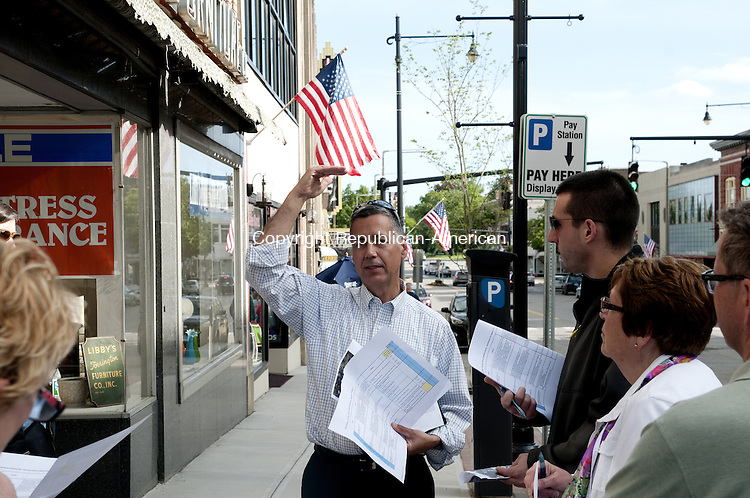 TORRINGTON, CT - 29 MAY 2014 -- David V. Sousa, Senior Planner and Landscape Architect for CDM Smith on Thursday leads a tour of downtown as a follow up to a study of downtown by the Connecticut Main Street Center last year.  Alec Johnson/ Republican-American