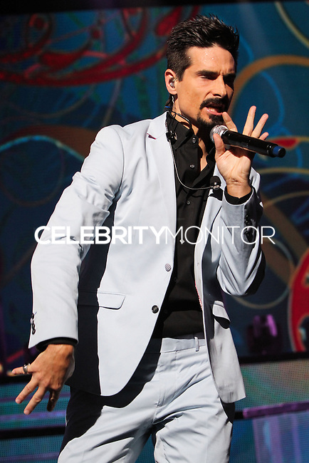 UNIVERSAL CITY, CA - SEPTEMBER 04: Kevin Richardson, Brian Littrell, AJ McLean, Howie Dorough and Nick Carter of the Backstreet Boys perform at Gibson Amphitheatre on September 4, 2013 in Universal City, California. (Photo by Xavier Collin/Celebrity Monitor)