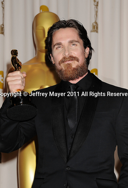 HOLLYWOOD, CA - FEBRUARY 27: Christian Bale  poses in the press room during the 83rd Annual Academy Awards held at the Kodak Theatre on February 27, 2011 in Hollywood, California.